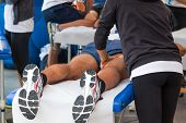 foto of massage oil  - athletes relaxation massage before sport event marathon muscles massage - JPG