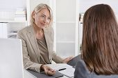 foto of interview  - Female managing director in a job interview with a young woman - JPG