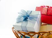 stock photo of gift basket  - Gift boxes on basket isolated on white background focus on blue - JPG