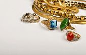 stock photo of jade blue  - Scrap gold jewelry with room for your store advertisement - JPG