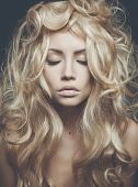 stock photo of perm  - Photo of beautiful woman with magnificent blond hair - JPG
