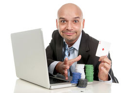 stock photo of addicted  - young lucky addict businessman on computer laptop making lots of money winning betting on internet poker with cards and chips on online gambling addiction isolated on white - JPG