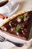 picture of tarts  - A piece of chocolate tart with hazelnut and coffee on a table close - JPG