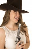 pic of pistols  - Cute cowgirl holding big pistol looking forward - JPG