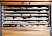 foto of fermentation  - Raw pieces of bread in the fermentation wooden cabinet - JPG