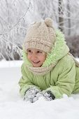 picture of wallow  - Happy little girl in warm clothes in winter outdoors - JPG