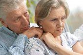 pic of elderly  - Portrait of a sad elder couple at home - JPG