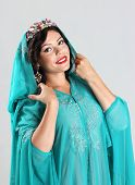 pic of yashmak  - Adult Beautiful arabian woman in blue abaya - JPG