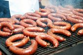 picture of steamy  - Lots of steamy delicious sausages on hot grill