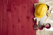 foto of wood craft  - red wood floor with a brush paint tools and helmet - JPG