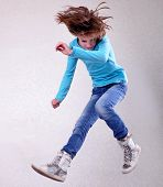 pic of sportive  - Portrait of a cute barefoot sportive cheerful happy girl with her hands up jumping and dancing - JPG