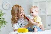 stock photo of inhalant  - Doctor holding inhaler mask for kid breathing - JPG