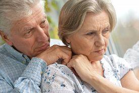 picture of sad  - Portrait of a sad elder couple at home - JPG