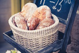 stock photo of bakeshop  - Wholemeal bread in a basket in the bakery - JPG