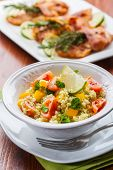 stock photo of tabouleh  - Fresh couscous salad for summer with tomato - JPG