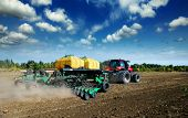 stock photo of plowing  - tractor in a field plowing - JPG