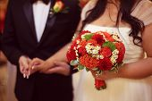 pic of wedding feast  - Capture of Bride holding red wedding bouquet - JPG