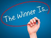 pic of winner  - Man Hand writing The Winner Is - JPG