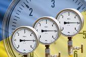 foto of air pressure gauge  - High pressure reading on gas wellhead isolated on flag Ukraine - JPG