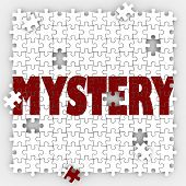 stock photo of crime solving  - Mystery word on puzzle pieces to illustrate solving an unknown problem or uncertainty with a solved answer - JPG