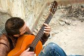 picture of rockabilly  - man with guitar in the street - JPG