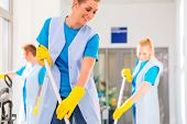 foto of work crew  - Commercial cleaning brigade working mopping the floor - JPG