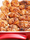 image of baked potato  - Baked halved potatos in a baking dish - JPG