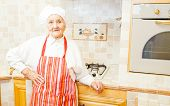 picture of apron  - Grandmother with hat and apron in her kitchen - JPG