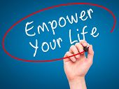 foto of empower  - Man Hand writing Empower your Life with black marker on visual screen - JPG