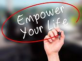 stock photo of empower  - Man Hand writing Empower your Life with black marker on visual screen - JPG