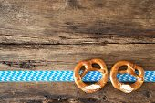 foto of pretzels  - Bavarian pretzels on old wooden background for Oktoberfest - JPG