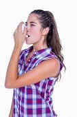stock photo of asthma  - Pretty brunette woman using asthma inhaler on white background - JPG