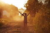 picture of beatitudes  - Happy girl running on a dusty road in the summer - JPG