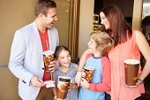 foto of 13 year old  - Family Standing Outside Cinema Together - JPG