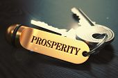 stock photo of prosperity  - Keys with Word Prosperity on Golden Label over Black Wooden Background - JPG