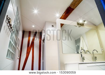 Modern Bathroom With Faucets On White Cabinet