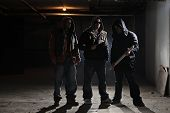 stock photo of mobsters  - Gang members in a dark alley - JPG