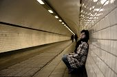 picture of drug addict  - sad mature woman in a tunnel - JPG