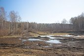 image of swales  - old road and spring flood in the Siberian forest - JPG