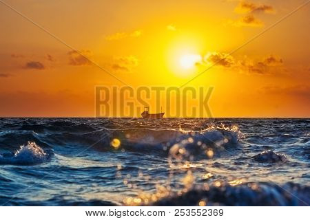Ship At Sunset In The