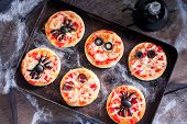 Mini Pizza For Halloween With Spiders, Mummy And Spider Web, Horizontal poster