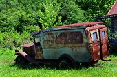 Old Jalopy, Rusting And Broken Down, Sits Besides An Abandoned Cabin In The Ozarks Of Arkansas.  You poster