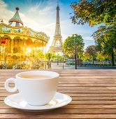 Cup Of Coffee With View Of Eiffel Tower With Merry Go Round From Trocadero At Sunrise, Paris, France poster
