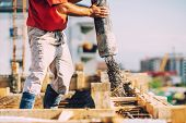Building Construction Worker Pouring Cement Or Concrete With Pump Tube poster