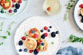 Sunday Breakfast With Cheesecake, Honey, Fresh Berries  And Mint. Cottage Cheese Pancakes Or Curd Fr poster