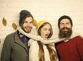 Happy Friends At Autumn Leaves In Scarf And Hat. Men And Woman, Happy Family Fashion. Season And Aut poster