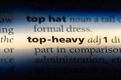 Top Heavy Word In A Dictionary. Top Heavy Concept. poster