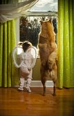 image of baby pig  - Baby girl and dog watching outside the window - JPG