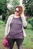 Beautiful Young Girl Plus-size In Casual Clothes Outdoors, Xxl Woman Portrait poster