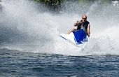 pic of waverunner  - action shot of man on seadoo with great waterspray - JPG
